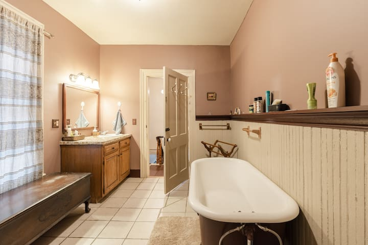 This spacious bathroom and glorious clawfoot tub are ready for you! We keep epsom salts on hand in case you need a good soak.