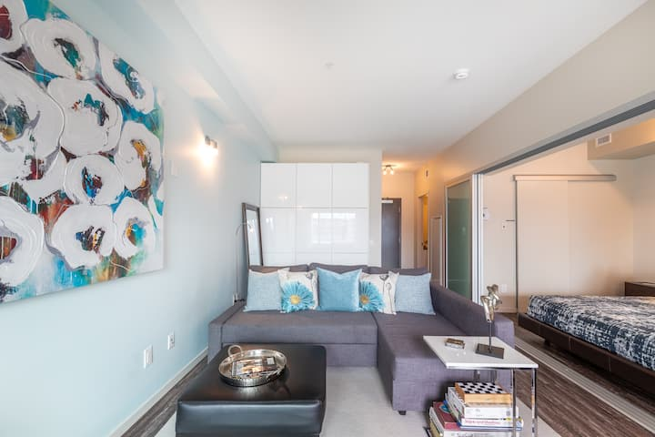 Retreat in Style: DT Condo with King Bed + Parking