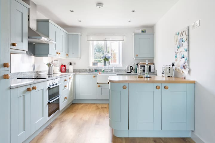 Our bright, modern kitchen is ideal for home-cooking or entertaining.