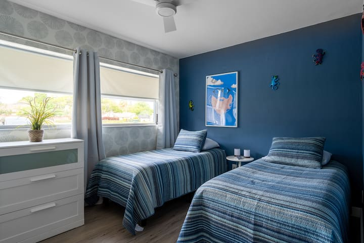 Third bedroom includes dual twin-size SleepNumber beds, which may be combined with the provided kit to create a single king size bed if desired.