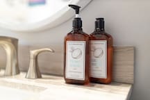 hand soap and hand lotion at bathroom sink.