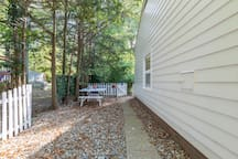 Once you arrive and park your car on the left side of the driveway, you take this stone path toward the back of the house and go through the white gate; this leads to the porch /door entry into the garage. This path is lighted at night.