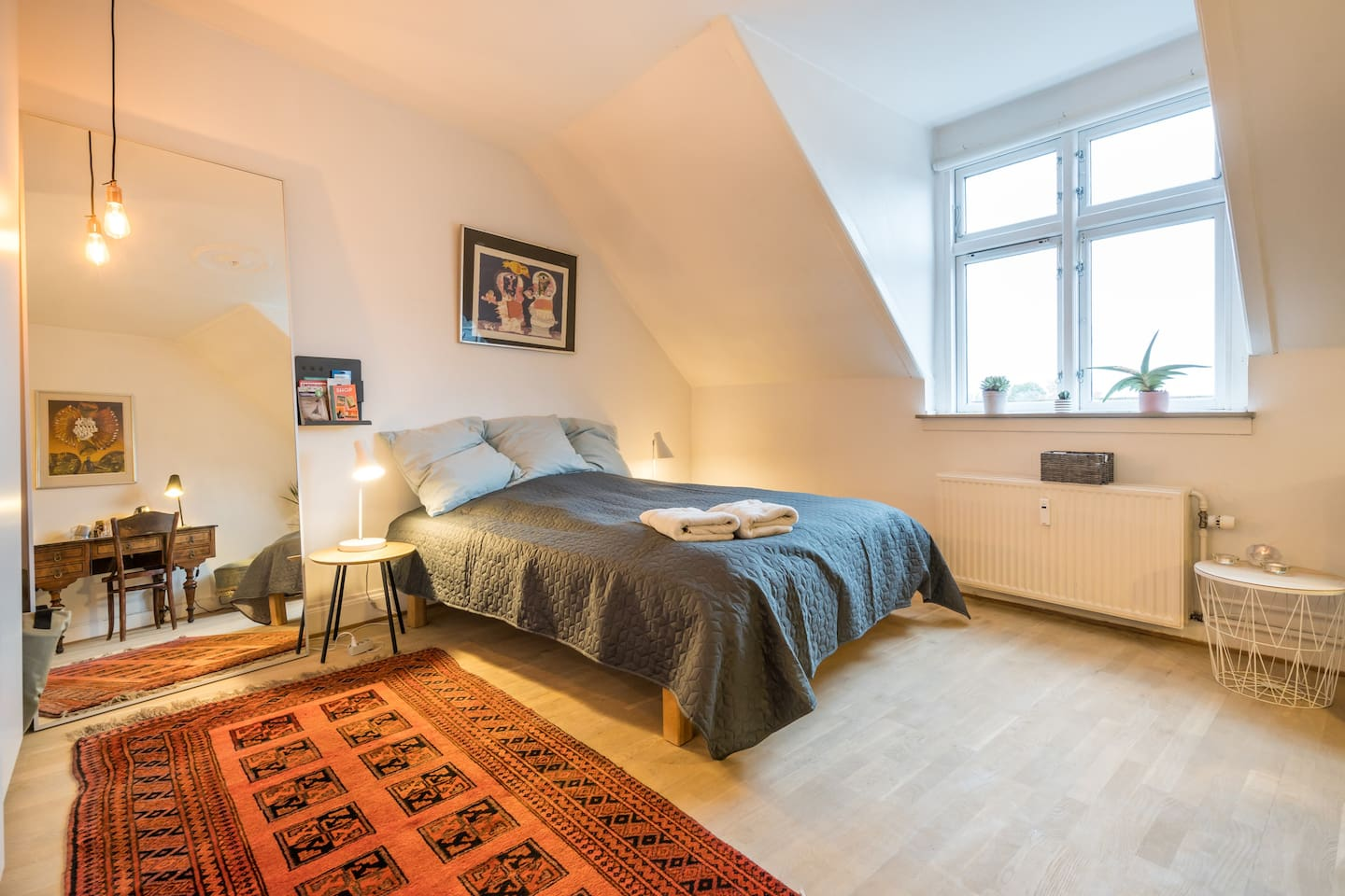 Large bedroom with queensize bed