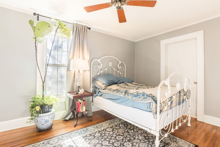 Second bedroom with luxury double mattress and office desk perfect for remote work.