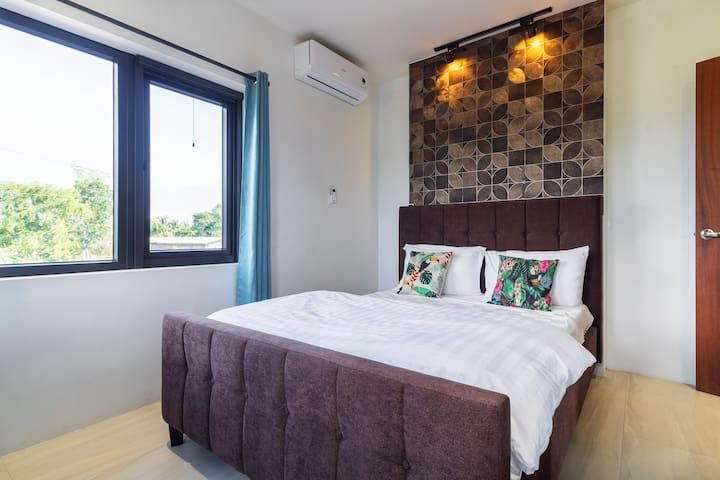 2nd floor room with mountain views - queen size bed - Aircon -blackout curtains -dresser with mirror provided