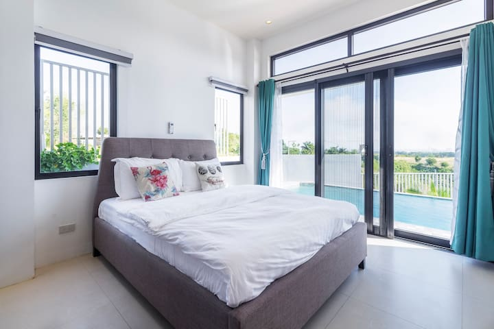 1st floor room Queen size bed overlooking the mountain views and infinity pool. Aircon. Sliding screen doors. Dresser with a mirror as well as blackout curtains provided too