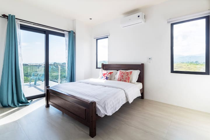 2nd floor room with balcony: - Queen size bed - Aircon -Clothes dresser and mirror provided -blackout curtains for deep sleep - Outdoor dining table and chair - Balcony with views of Mactan and Cebu