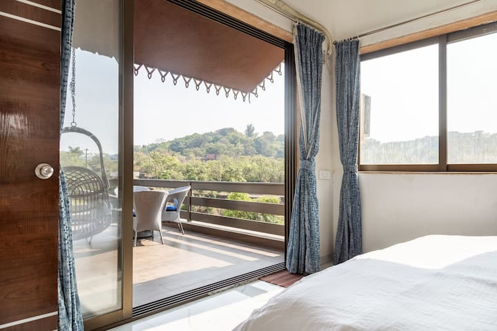 Open feel of guest bedroom