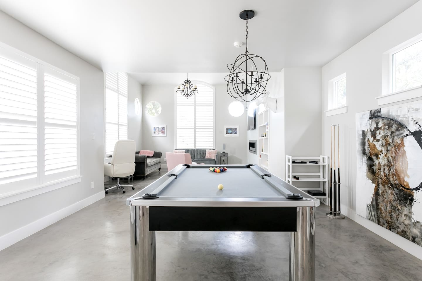 Beautiful contemporary 8ft pool table w/ polished concrete flooring throughout the downstairs.