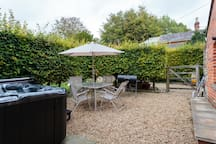 Relax on the patio with Hot Tub and Free Breakfast