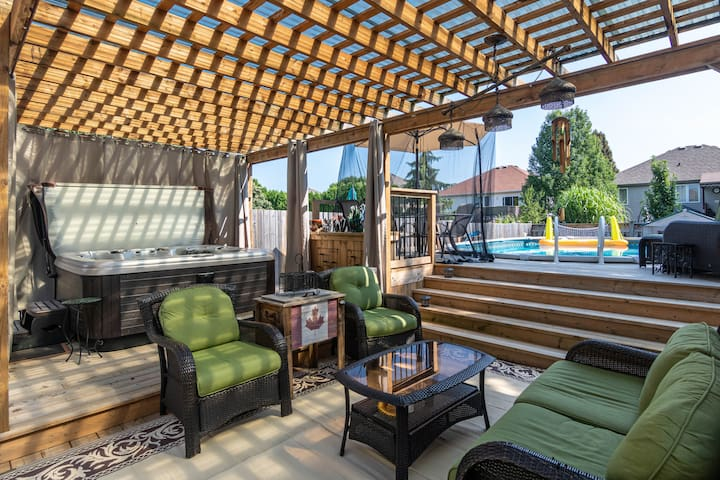 Best patio in Tecumseh. You can enjoy a down time with a glass of wine with friends or relax in the Jacuzzi.