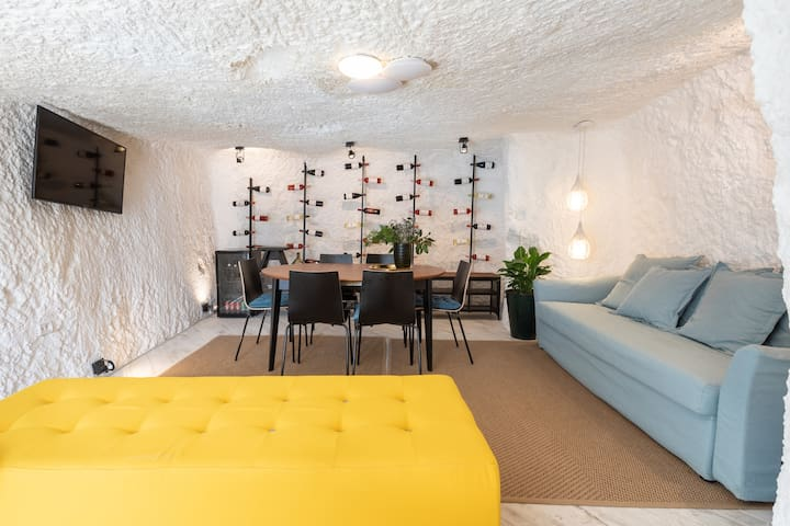 Living room cave with smart TV and Netflix, minibar and wine selection available for purchase