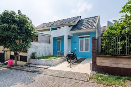Strategic blue house at gate of Bogor city