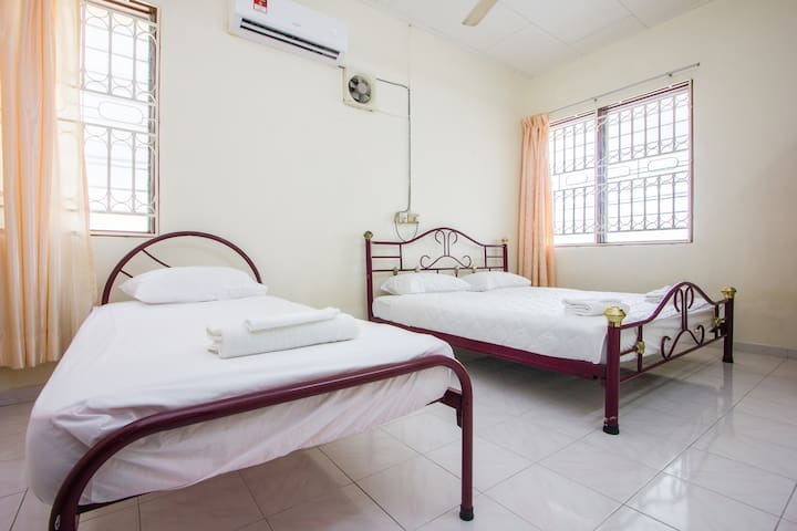 A king size bed and single bed in bed room 1