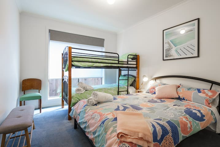 Bedroom 4 contains a double bed and a set of single bunks, making it ideal for a family group to all sleep in the same room.