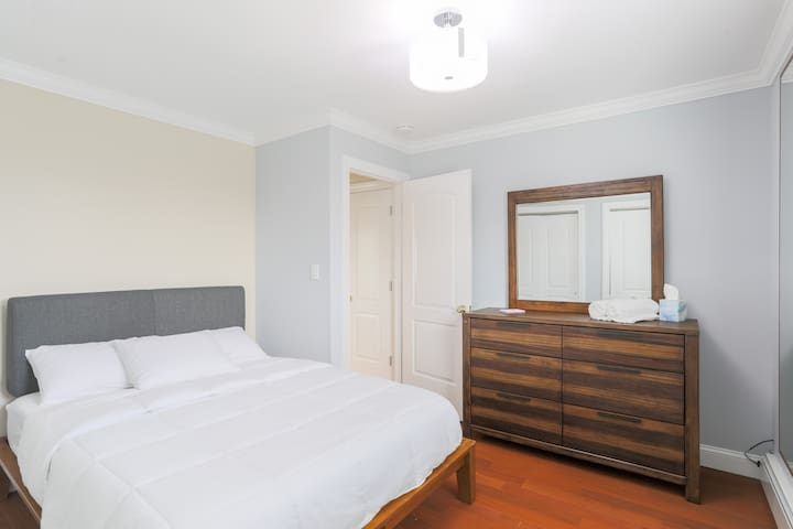 The spacious second bedroom with views out to the neighborhood below