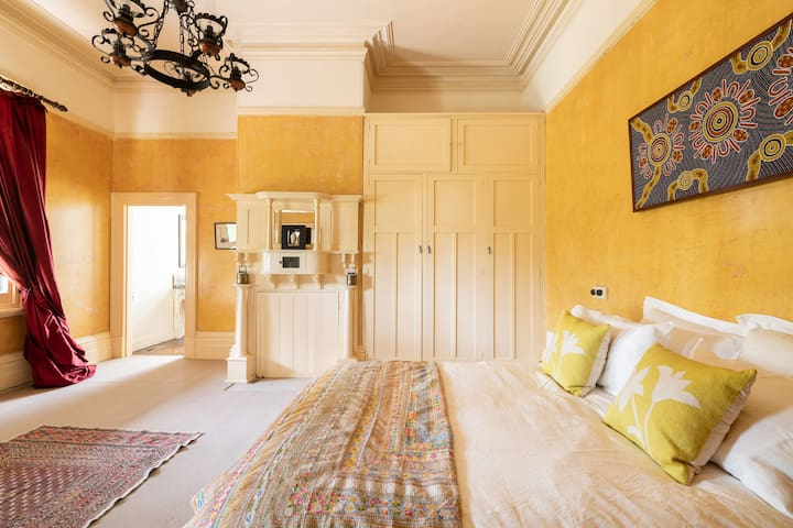 Large bedroom with majestically high ceilings. Two extra single beds available for family stays