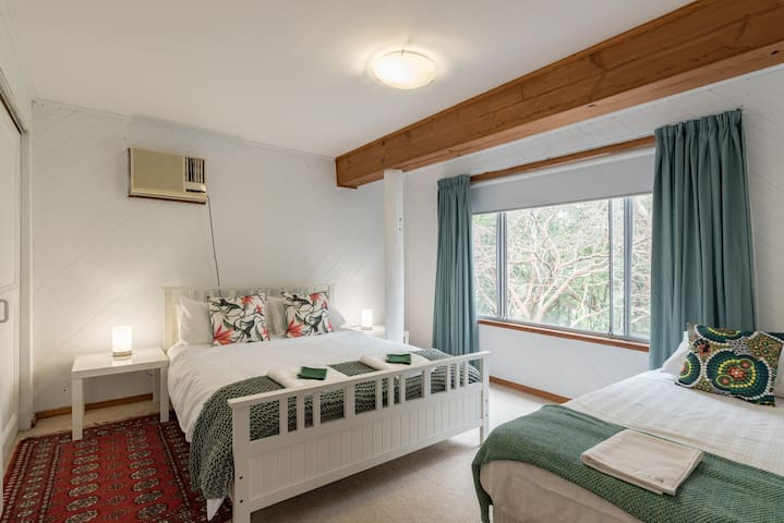 Bedroom with Queen bed and single bed. Aircon, block out blind and curtains.