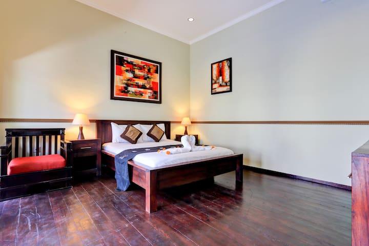 Bedroom,No two with classic teak wood floors.