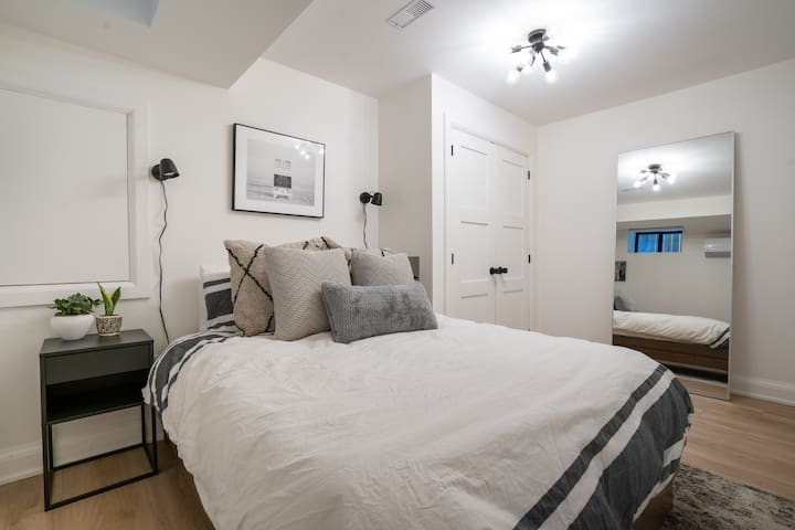 Queen size bed with large closet which includes drawer storage.  Separate heat/ac unit in room