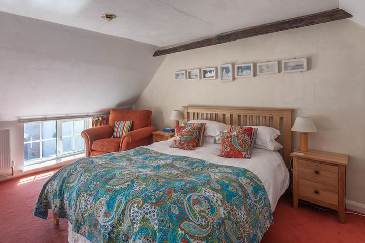 King size bed on the third floor, under the thatch.
