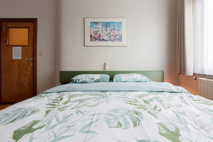 Cosy master bedroom with bathroom.