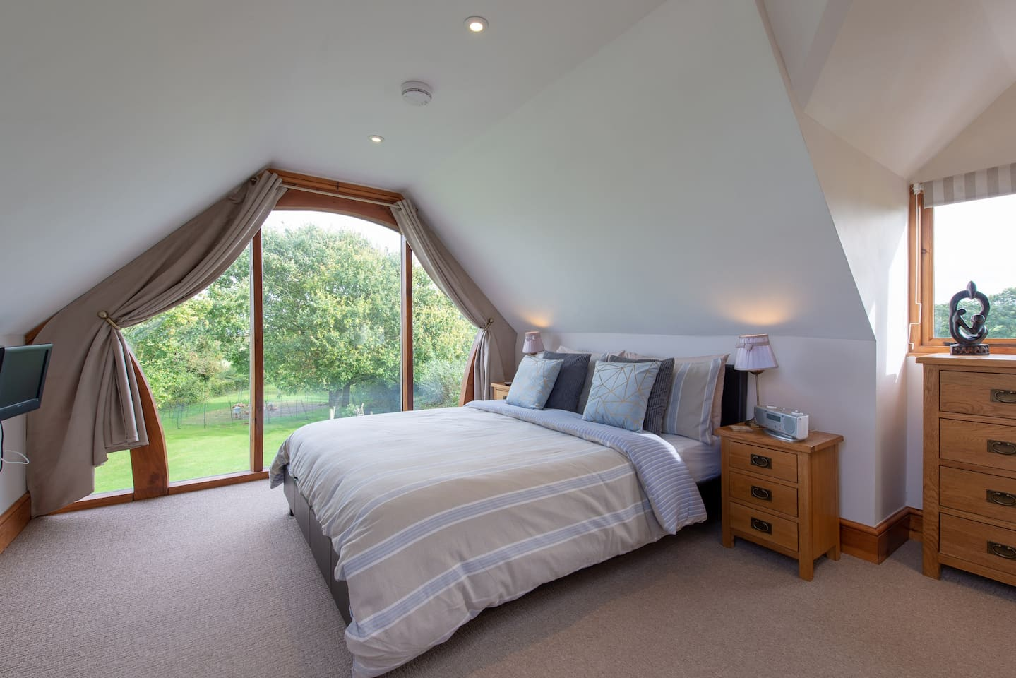 The beautiful floor to ceiling window has idyllic views of the Somerset countryside from the king size bed