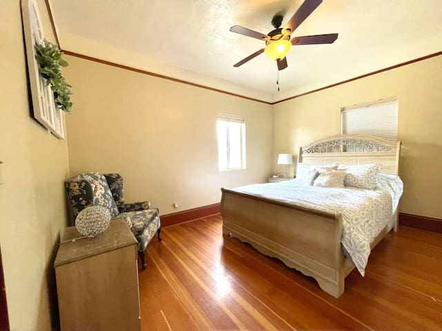Bedroom #3 features a Queen-Size, Sleigh Bed over the original wood flooring. Under the lamp on the nightstand, you'll find the power station to charge any electronics you've brought with you. There's a full-sized closet to stow your gear while you stay.
