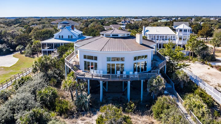 Surprise awaits as you enter this exquisite front row beach home