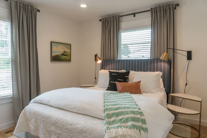The master bedroom, located at the back of the house, with its own bathroom and walk in closet.