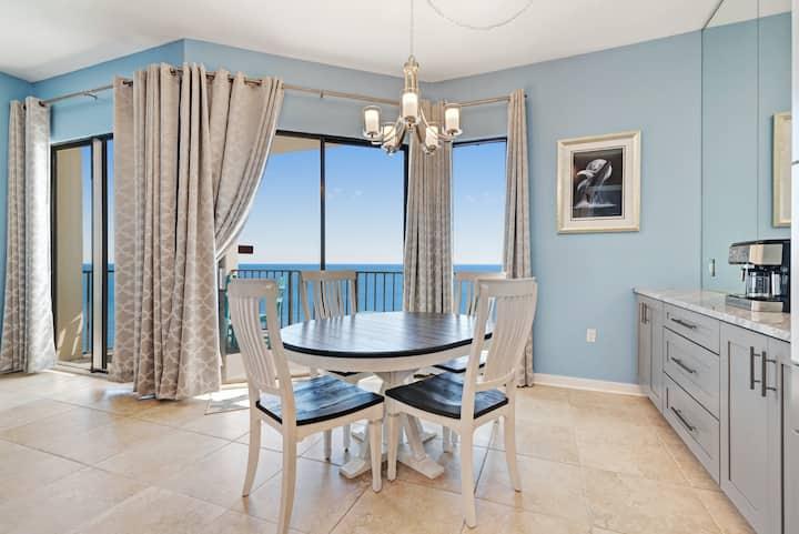 Casual beachfront getaway w/ a shared pool, ocean views, & beach access