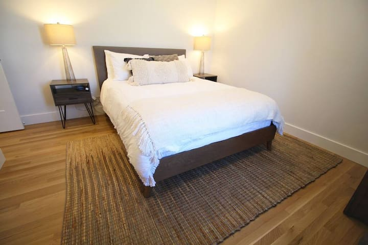 The middle bedroom is ready for you with a comfy bed and plugs for your devices on both sides.