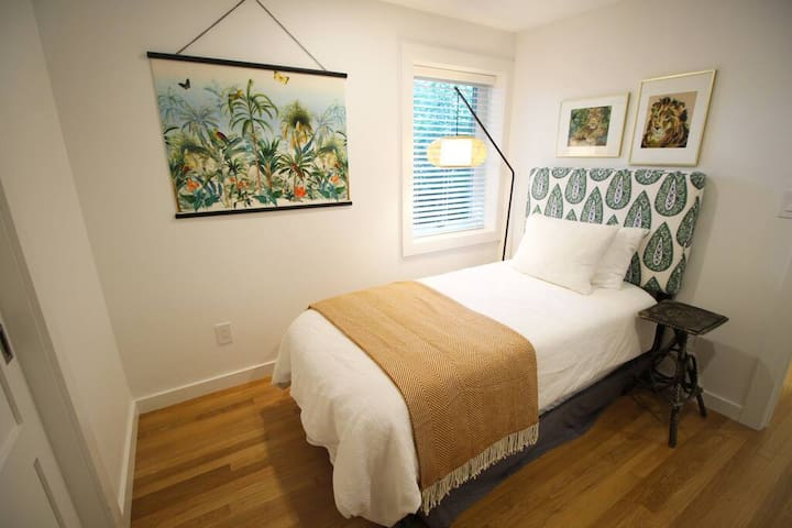 The sweet little twin bedroom is a perfect spot for one.