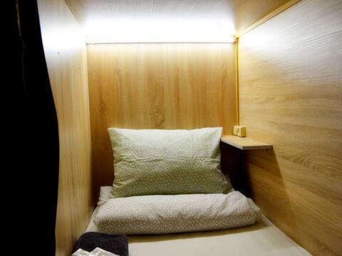 Single capsule room. Capsule Hotel Tolmachevo
