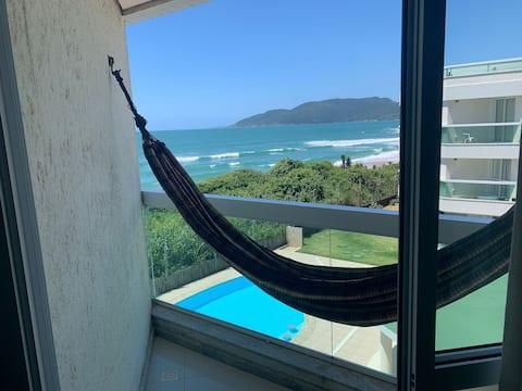 Apto pé na areia com vista para o mar! Perfeito para Home Office