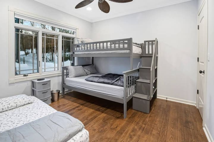 Bunk room sleeps up to 4 with trundle bed shown
