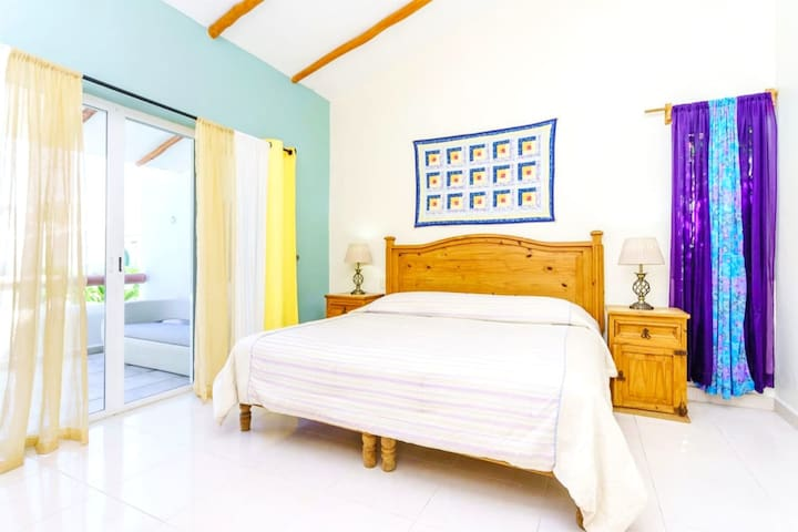 The master bedroom with a king-size bed and an en suite bathroom.
