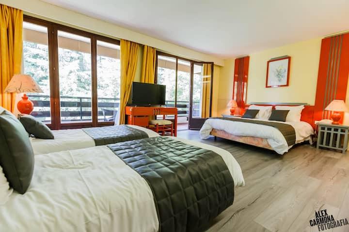 Chambre familiale dans grand hôtel près de nature