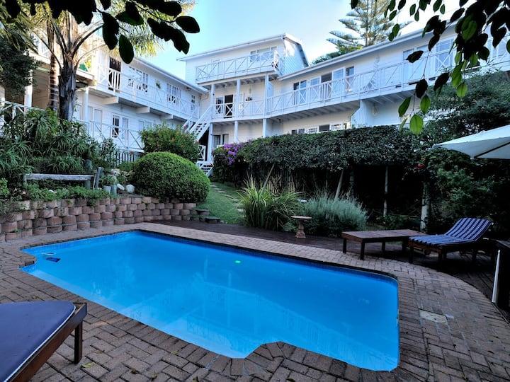 Brenton Beach House -  Garden and pool view