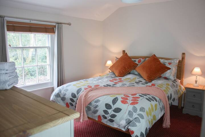Brewer's Cottage - Bedroom with Double Bed, Wardrobes, Chest of Draws, Smart TV, Bedside Tables and Lamps etc.