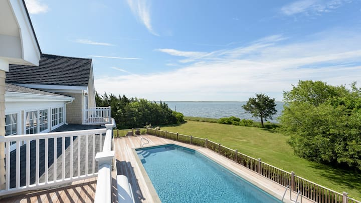 New Listing: Stay in this quintessential Hamptons waterfront home graced with panoramic views across the bay and sunsets over the water!