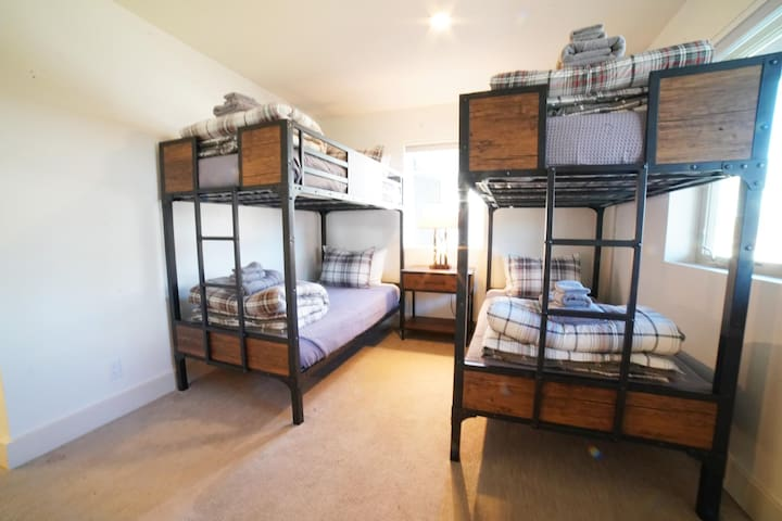 Bedroom #2 has two twin-over-twin bunk beds, made in an attractive mountain modern style.