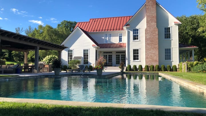 New Listing: Upstate modern barn with heated pool, private tennis/basketball court, an abundance of light, close to skiing and hiking, perched on 17 acres of rolling hills in upstate NY.