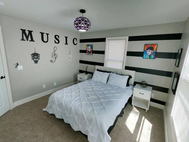 The music room has a queen sized bed, two night stands and a walk in closet with plenty of storage