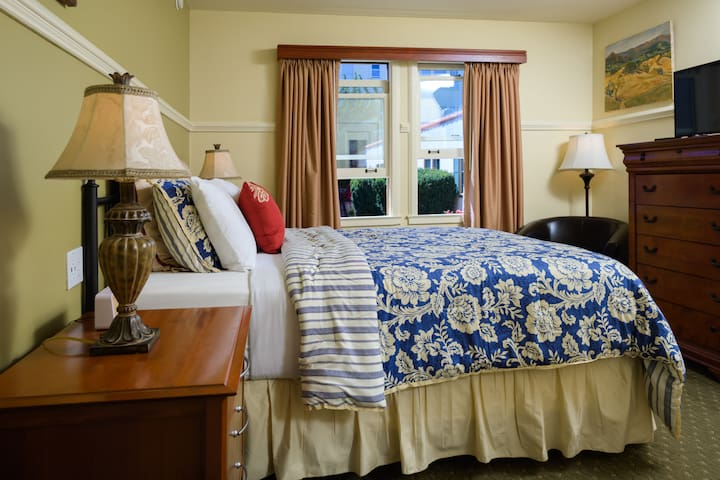 Slip into a weekend of peaceful rest and recuperation with the right size bed for your space, like this queen-size bed by the window side and amazing views.