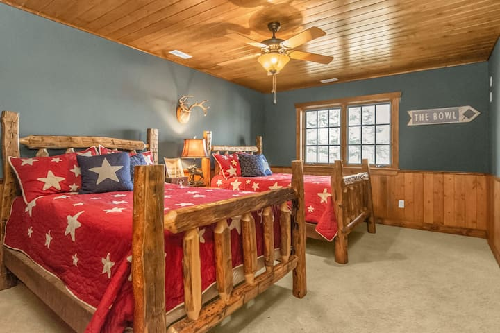 The Second lower Guest Suite offers two Full beds and a shared full bath