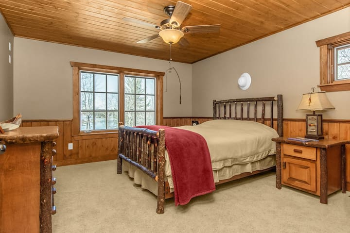 The Queen upper Guest Suite has lake views with a shared full bath