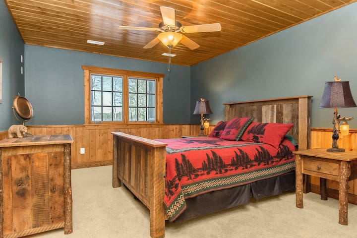 The Queen lower Guest Suite with lake views and shared full bath