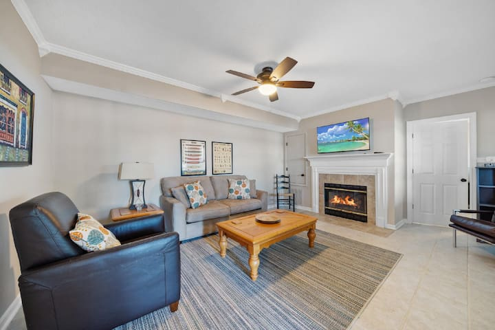 """Downstairs Den with 50""""smart TV and a Gas fireplace"""