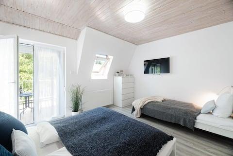Casa de vacaciones con aire acondicionado y jardín privado